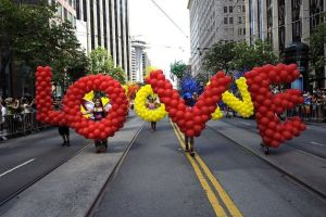 "The parade started with two balloon sculptures that read ""LOVE WON."""