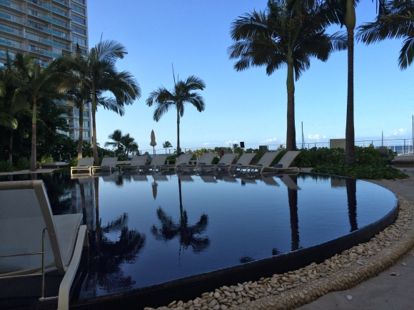 One of the two pools at hour hotel, the Sunset Pool at The Modern Honolulu...