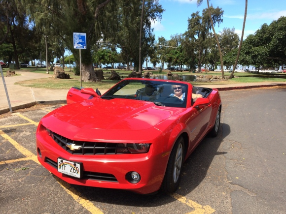 We rented a convertible to drive around the island.  We got upgraded, FOR FREE, to this nice red Camaro!