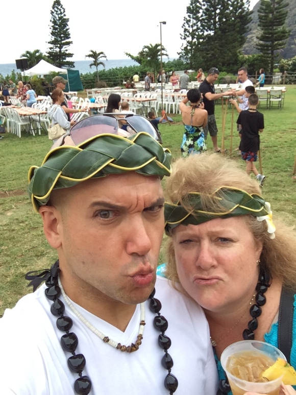 """At a great luau called """"Chief 's Luau.""""  Great food, great show and lots of fun activities...Yes, we made our headbands!"""